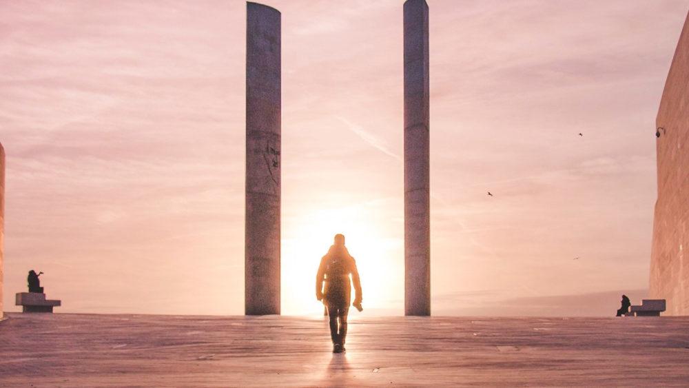 Man walking into the sun